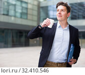 Купить «Professional man in jacket walking with coffee», фото № 32410546, снято 20 апреля 2017 г. (c) Яков Филимонов / Фотобанк Лори