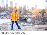 Купить «Adorable little girl with view of ice-rink in Central Park on Manhattan in New York City», фото № 32415242, снято 1 января 2018 г. (c) Дмитрий Травников / Фотобанк Лори