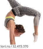 Купить «Female acrobat exercising on circus stands», фото № 32415370, снято 13 мая 2016 г. (c) Гурьянов Андрей / Фотобанк Лори
