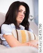 Купить «Adult sad female melancholy with pillow», фото № 32415790, снято 2 июня 2017 г. (c) Яков Филимонов / Фотобанк Лори