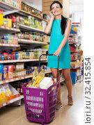 Купить «Woman with cart talking on the phone», фото № 32415854, снято 6 июня 2017 г. (c) Яков Филимонов / Фотобанк Лори