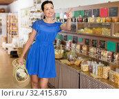 Купить «Woman customer carrying shopping bags», фото № 32415870, снято 13 июня 2017 г. (c) Яков Филимонов / Фотобанк Лори