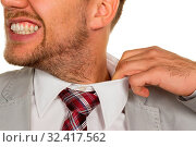 Купить «Ein Mann ( Manager ) fühlt sich eingeengt. Der Kragen platzt.», фото № 32417562, снято 8 июля 2020 г. (c) age Fotostock / Фотобанк Лори