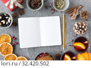 Купить «notebook, pencil and hot mulled wine on christmas», фото № 32420502, снято 4 октября 2018 г. (c) Syda Productions / Фотобанк Лори