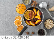 Купить «pot with hot mulled wine, orange slices and spices», фото № 32420510, снято 4 октября 2018 г. (c) Syda Productions / Фотобанк Лори