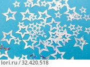 star shaped confetti decoration on blue background. Стоковое фото, фотограф Syda Productions / Фотобанк Лори