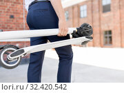 Купить «businessman with folding scooter in city», фото № 32420542, снято 1 августа 2019 г. (c) Syda Productions / Фотобанк Лори