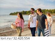 Купить «happy friends walking along summer beach», фото № 32420554, снято 31 августа 2019 г. (c) Syda Productions / Фотобанк Лори