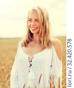Купить «smiling young woman in white dress on cereal field», фото № 32420578, снято 31 июля 2016 г. (c) Syda Productions / Фотобанк Лори