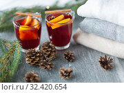 Купить «mulled wine with orange and spices, cones and fir», фото № 32420654, снято 4 октября 2018 г. (c) Syda Productions / Фотобанк Лори