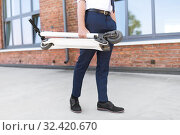 Купить «businessman with folding scooter on rooftop», фото № 32420670, снято 1 августа 2019 г. (c) Syda Productions / Фотобанк Лори