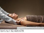 Купить «woman having face and head massage at spa», фото № 32420678, снято 13 октября 2019 г. (c) Syda Productions / Фотобанк Лори