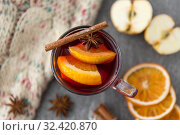 Купить «glass of hot mulled wine with orange and cinnamon», фото № 32420870, снято 4 октября 2018 г. (c) Syda Productions / Фотобанк Лори