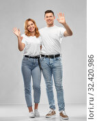 happy couple in white t-shirts waving hands. Стоковое фото, фотограф Syda Productions / Фотобанк Лори