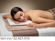 Купить «young woman lying at spa or massage parlor», фото № 32421010, снято 13 октября 2019 г. (c) Syda Productions / Фотобанк Лори