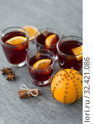 Купить «glasses of mulled wine with orange and cinnamon», фото № 32421086, снято 4 октября 2018 г. (c) Syda Productions / Фотобанк Лори