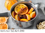 Купить «pot with hot mulled wine, orange slices and spices», фото № 32421090, снято 4 октября 2018 г. (c) Syda Productions / Фотобанк Лори