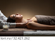 Купить «woman having face and head massage at spa», фото № 32421262, снято 13 октября 2019 г. (c) Syda Productions / Фотобанк Лори