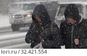Купить «Two women in black winter jacket walking on sidewalk during Pacific snow cyclone», видеоролик № 32421554, снято 15 ноября 2019 г. (c) А. А. Пирагис / Фотобанк Лори