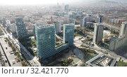 Купить «Aerial view of Barcelona cityscape with a modern apartment buildings, Spain», видеоролик № 32421770, снято 5 марта 2019 г. (c) Яков Филимонов / Фотобанк Лори
