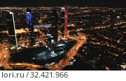 Купить «Night view of the four towers (Cuatro Torres) of the business district in Madrid. Spain», видеоролик № 32421966, снято 16 ноября 2019 г. (c) Яков Филимонов / Фотобанк Лори