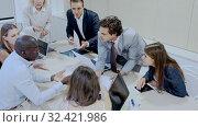 Купить «Expressive business people of different nationalities discussing in meeting room, developing work strategy», видеоролик № 32421986, снято 5 апреля 2020 г. (c) Яков Филимонов / Фотобанк Лори