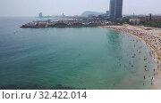 Купить «Panoramic view from the drone of coastline and beach of Barcelona. Spain», видеоролик № 32422014, снято 7 июля 2019 г. (c) Яков Филимонов / Фотобанк Лори