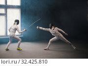 Купить «A fencing training - two women having a duel», фото № 32425810, снято 4 ноября 2019 г. (c) Константин Шишкин / Фотобанк Лори
