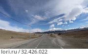 Купить «Driving along mountain road Chuysky Tract along Kurai Ridge on Altai at Spring season», видеоролик № 32426022, снято 16 июля 2019 г. (c) Serg Zastavkin / Фотобанк Лори