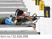 Купить «Sportswoman biathlete Lee Hyunju (South Korea) rifle shooting in prone position», фото № 32426098, снято 12 апреля 2019 г. (c) А. А. Пирагис / Фотобанк Лори