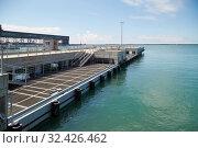 Купить «TUAPSE, RUSSIA, AUGUST 12, 2018: Small sea pier for loading and unloading passengers», фото № 32426462, снято 12 августа 2018 г. (c) Олег Белов / Фотобанк Лори