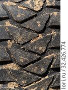 Купить «Close-up view of old used rubber mud terrain tire with worn wear-resistant tread. Black muddy sport utility vehicle tire», фото № 32426774, снято 12 сентября 2019 г. (c) А. А. Пирагис / Фотобанк Лори