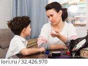 Woman having serious conversation with son. Стоковое фото, фотограф Яков Филимонов / Фотобанк Лори