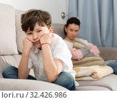 Купить «Offended tweenager after disagreements with mom», фото № 32426986, снято 28 марта 2019 г. (c) Яков Филимонов / Фотобанк Лори