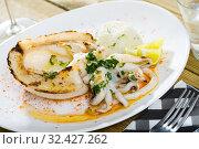 Купить «Baked cuttlefish with boiled rice», фото № 32427262, снято 5 декабря 2019 г. (c) Яков Филимонов / Фотобанк Лори
