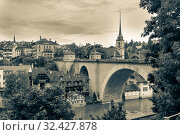 Bern, Switzerland - August 07, 2019: Beautiful landscape of Bern with old bridge. Bern is capital of Switzerland and fourth most populous city. Редакционное фото, фотограф Григорий Стоякин / Фотобанк Лори