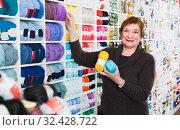 Купить «Female buyer is buying colorful yarn for their hobby», фото № 32428722, снято 10 мая 2017 г. (c) Яков Филимонов / Фотобанк Лори