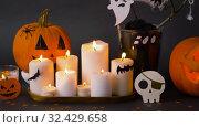 Купить «pumpkins, candles and halloween decorations», видеоролик № 32429658, снято 14 ноября 2019 г. (c) Syda Productions / Фотобанк Лори