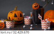 Купить «pumpkins, candies and halloween decorations», видеоролик № 32429670, снято 14 ноября 2019 г. (c) Syda Productions / Фотобанк Лори