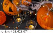 Купить «pumpkins, candles and halloween decorations», видеоролик № 32429674, снято 14 ноября 2019 г. (c) Syda Productions / Фотобанк Лори
