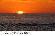 Каспийское море на закате. Солнце садится в море. Caspian Sea at sunset. The sun sets in the sea. Стоковое видео, видеограф Евгений Романов / Фотобанк Лори