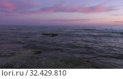 Купить «Каспийское море на закате. Волны набегают на скалистый берег. Caspian Sea at sunset. Waves run onto a rocky shore.», видеоролик № 32429810, снято 7 февраля 2019 г. (c) Евгений Романов / Фотобанк Лори
