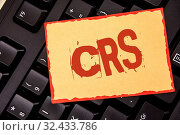 Купить «Word writing text Crs. Business concept for Common reporting standard for sharing tax financial information written Sticky Note Paper placed Black Keyboard. Top view.», фото № 32433786, снято 13 декабря 2019 г. (c) easy Fotostock / Фотобанк Лори