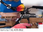 Купить «Sportsman biathlete Rusinov Vladislav Khanty-Mansiysk rifle shooting prone position. Biathlete in shooting range», фото № 32439862, снято 12 апреля 2019 г. (c) А. А. Пирагис / Фотобанк Лори