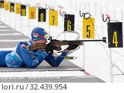 Купить «Sportsman biathlete Agin Pavel Kamchatka Peninsula rifle shooting in prone position. Biathlete in shooting range», фото № 32439954, снято 12 апреля 2019 г. (c) А. А. Пирагис / Фотобанк Лори