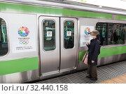 Купить «Stickers about Tokyo for Olympic Games candidate city are on cars of train. Japanese woman waits door opening. Токио, Япония», фото № 32440158, снято 11 апреля 2013 г. (c) Кекяляйнен Андрей / Фотобанк Лори