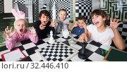 Купить «kids play in quest room in chess style», фото № 32446410, снято 21 октября 2017 г. (c) Яков Филимонов / Фотобанк Лори