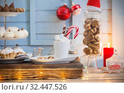 Christmas bar cacao decoration with cookies and sweets on blue wooden background in vintage style. Стоковое фото, фотограф Майя Крученкова / Фотобанк Лори