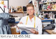Dressmaker at work – creating dress style. Стоковое фото, фотограф Яков Филимонов / Фотобанк Лори