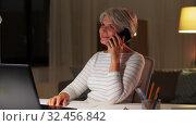 Купить «old woman calling on smartphone at home at night», видеоролик № 32456842, снято 18 ноября 2019 г. (c) Syda Productions / Фотобанк Лори